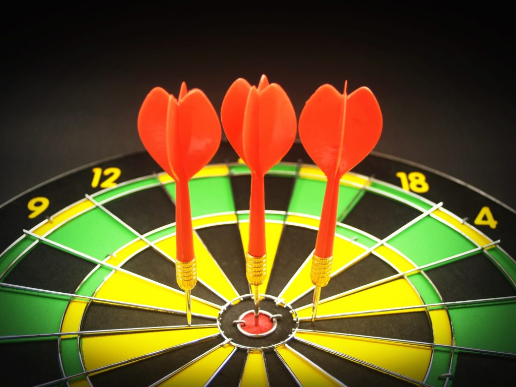 Picture of darts on dartboard symbolizing objectives.