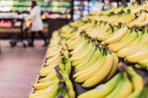 Picture of bananas in a grocery store.
