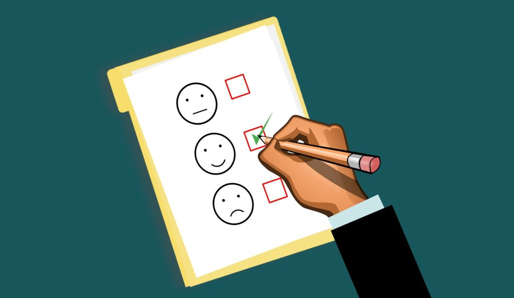 Picture of a feedback sheet with indifferent, smiley, and frown faces.