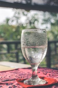 Picture showing a glass filled halfway with water.