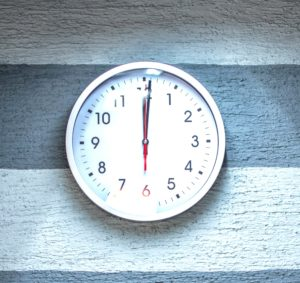Picture of a clock at noontime.