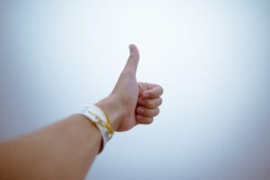 Picture of a hand giving a thumbs up.