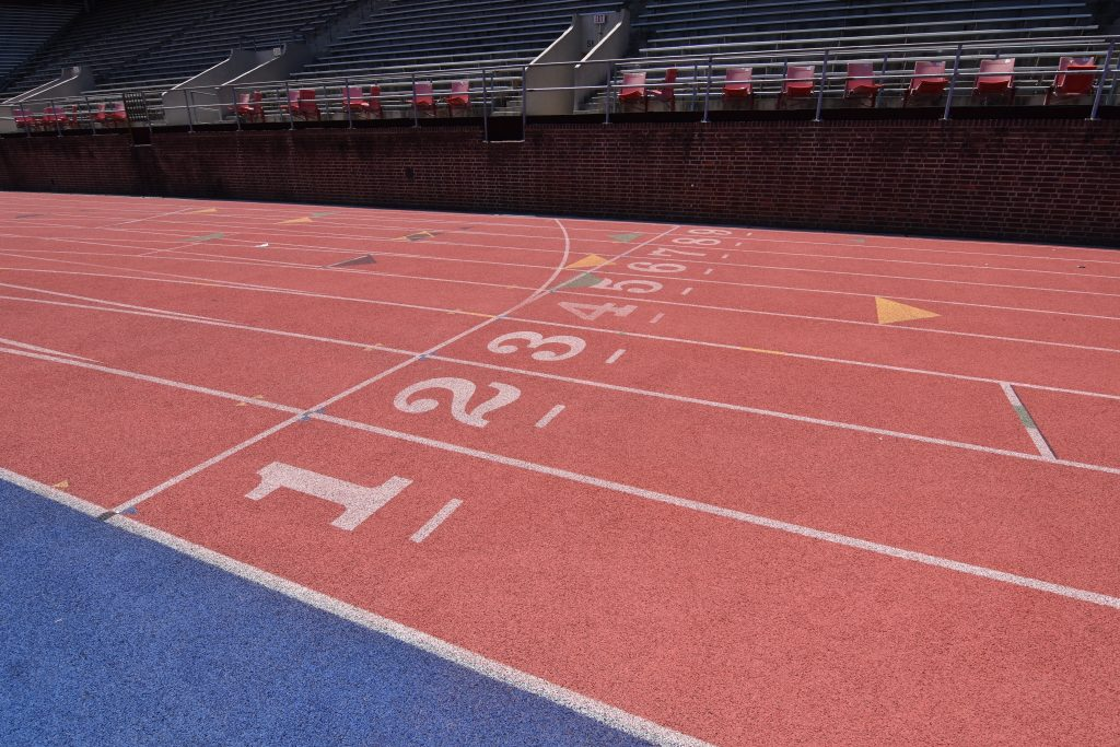 Picture of an outdoor, running track.