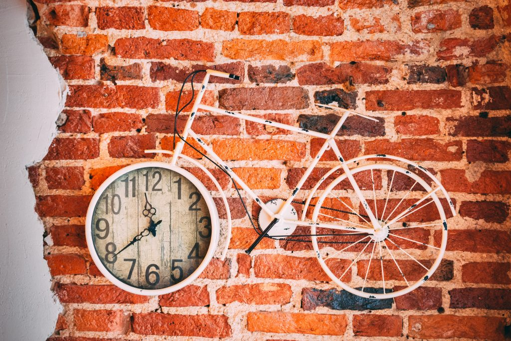 Picture of a bike with a clock embedded in the front wheel.