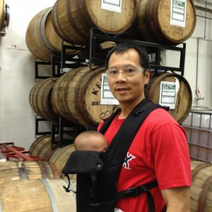 Picture of me wearing my infant son on the brewery tour at Doghead Head.